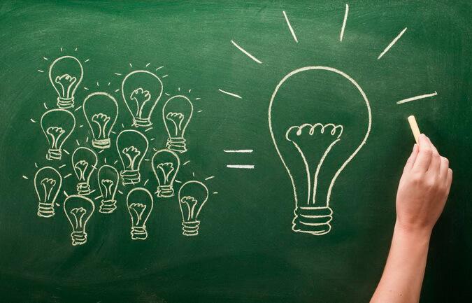 light bulbs sketched on chalkboard Many small ideas make a big one